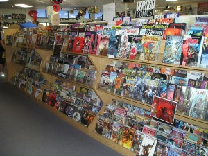 about time warp comics - comic racks have signage to help point out areas of interest