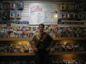 Wayne Winsett in front of new release department at time warp comics in Boulder Colorado