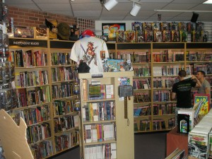 about time warp comics - graphic novels stretch across 2 walls